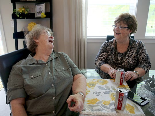 Joyce Risher of Bremerton, left, shares a laugh with her newly found sister, Beverly Meier of Sacramento, California.