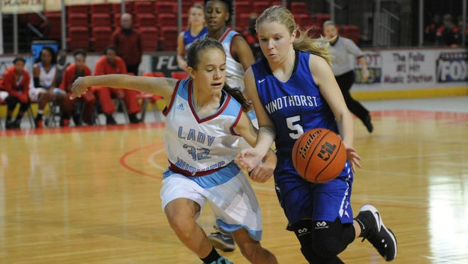 Hirschi's Michinsi Montoya stays close to Windthorst's Grace Hoegger Saturday, Dec. 3, 2016, in the Wichita Falls Classic at Kay Yeager Coliseum.