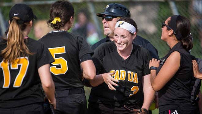 Padua pitcher Abby Cunningham is congratulated by teammates after escaping a bases loaded jam in Padua Academy's 1-0 win over Red Lion Christian Academy on Thursday afternoon.