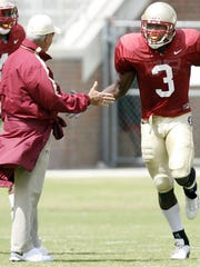 Myron Rolle gives a high five to former FSU coaching legend Bobby Bowden in 2006.