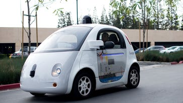 A self-driving car passes through a parking lot at Google's headquarters in Mountain View, Calif., on Jan. 8, 2015.