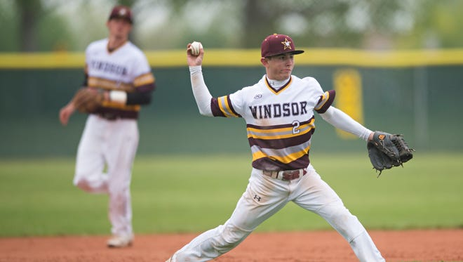 Braden Peninger of Windsor sends the ball to first base during a game against Weld Central High School during regionals on Saturday. Peninger and the Wizards begin play in the Class 4A state tournament Friday.