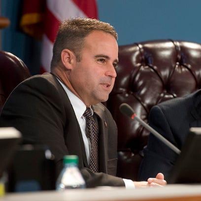 Escambia County Commissioner Doug Underhill, left,