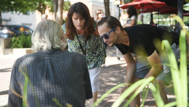 Outreach workers Emily Harms and Nick Verni-Lau talk with a man in Old Town on Thursday, July 7, 2016. Outreach Fort Collins is a new organization striving to develop relationships with homeless and at risk people in the downtown area to ease tensions between the population and business.