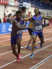 Timothy Ebbs of Monroe College hands off to Elijah