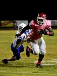 Crockett County's Jordan Branch avoids a tackle from