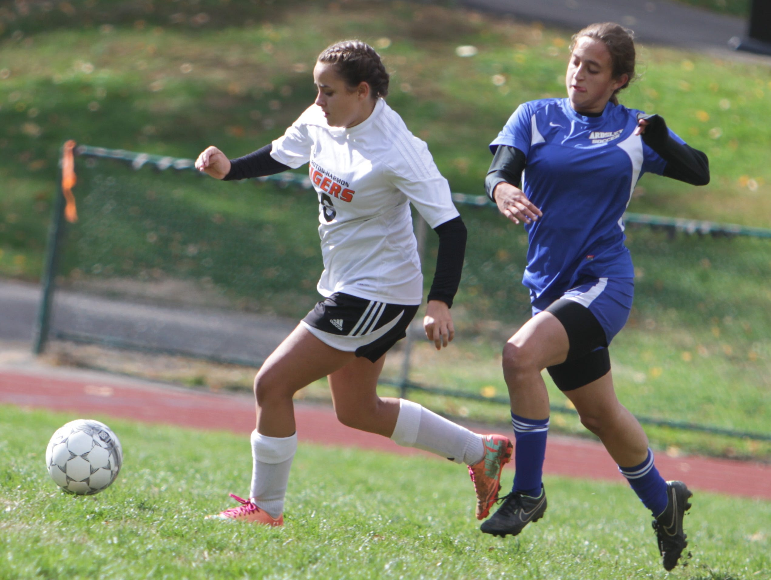 Croton Harmon's Astrella Dacosta and Ardsley's Samantha Torrellas chase after a loose ball during a game at Spencer Field, Croton-on-Hudson on Sunday, October 18, 2015. The match ended in a 2-2 draw.