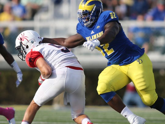 Delaware's Bilal Nichols grabs for Richmond quarterback Kyle Lauletta in the first quarter at Delaware Stadium Saturday.