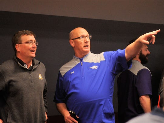 Abilene High head football coach Del Van Cox, left, talks with Weatherford executive athletic director Richard Scoggin during the UIL Realignment meeting at the Birdville ISD Fine Arts and Athletics Complex on Thursday, Feb. 1, 2018.