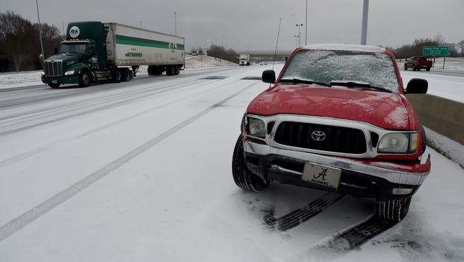 A pick-up truck is abandoned along the median of I-565 near Jordan Lane as a winter storm moved across the Tennessee Valley and snow mixed with freezing rain and sleet combined to turn the roads into an icy mess recently in Huntsville. Wintry weather is expected to continue in the northern part of the state.
