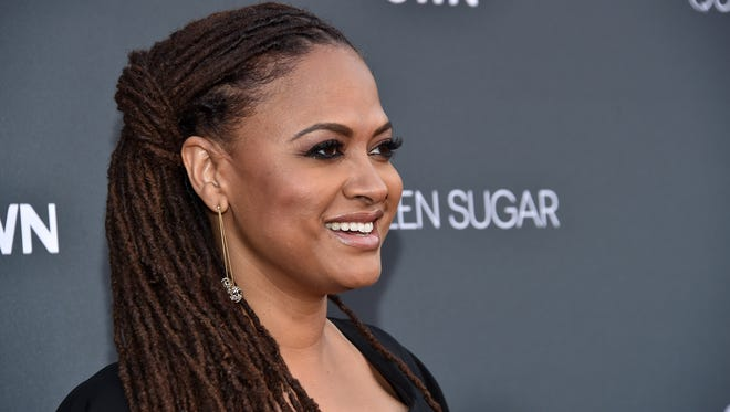 Ava DuVernay, whose 'Queen Sugar' made its debut on OWN this month, premiered her documentary '13th' at New York Film Festival Friday.