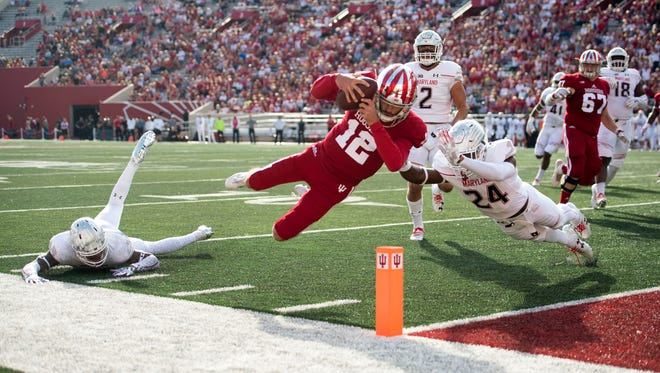 Hoosiers quarterback Zander Diamont (12) dives into the end zone with the ball for a touchdown during the first quarter of the game at Memorial Stadium.