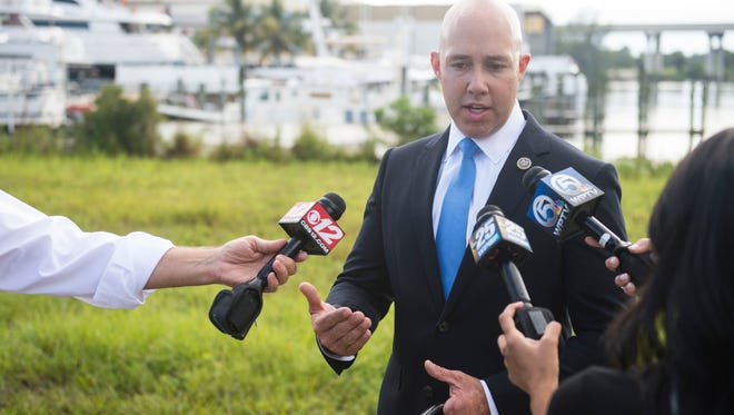 U.S. Rep. Brian Mast, R-Palm City, opposed the earliest drafts of the Republican tax bill but voted to support it. The bill passed the Senate and House, and now awaits President Donald Trump's signature.