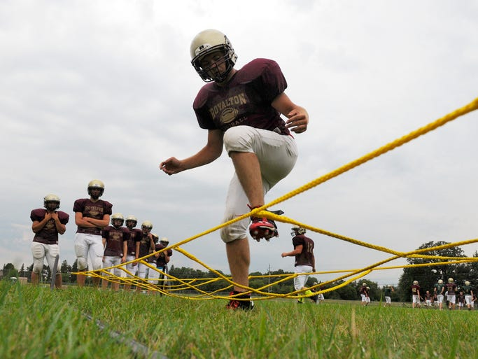 Players side step through the ropes during a drill at practice in Royalton.