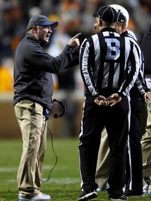 Kentucky head coach Mark Stoops talks to the officials during an NCAA college football game against Tennessee in Knoxville, Tenn., Saturday, Nov. 15, 2014. Tennessee won 50-16.  (AP Photo/Knoxville News Sentinel, Kevin Martin)