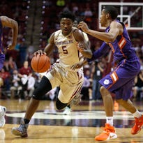 FSU's Malik Beasley drives past Clemson's Donte Grantham during their game at the Tucker Civic Center on Saturday.