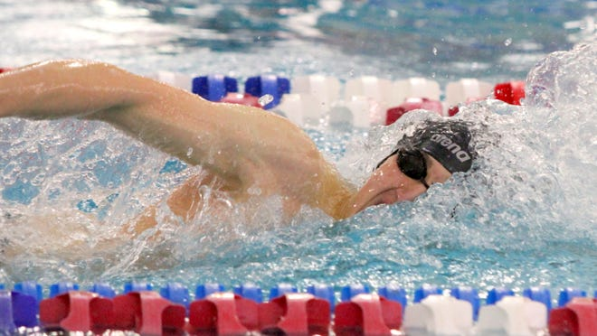 Reid Cagir of Corning on his way to winning the 100-yard freestyle during the Section 4 Class A swimming championships at Owego Free Academy on Feb. 14.