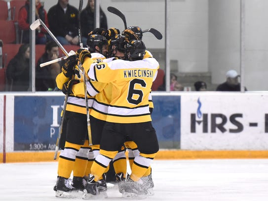 Colorado College players celebrate a goal in the first