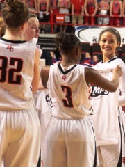 Deja Turner (far right) smiles in the aftermath of the win. Holy Cross 35, Allen County-Scottsville 32. KHSAA Sweet 16 state championship game. March 15, 2015.