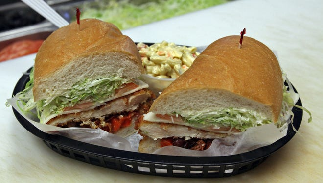 This is Sal's Special Breaded Chicken with bacon, mozzarella, garlic roast peppers, lettuce, tomato and mayo served on an Italian Hero. It is one of the popular sandwiches at Sal's Family Deli & Grill in Middlesex.