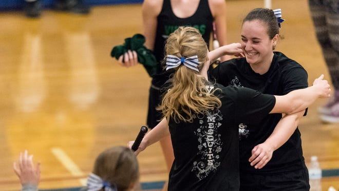 Mesquite's Natalie Weber is congratulated by her teammates after winning the Div 2 finals match of the AIA Badminton championships on Saturday, Oct. 22, 2016, at Independence High School in Phoenix.