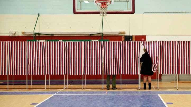 People vote at a polling station in Concord, N.H.,