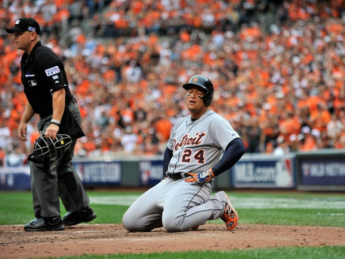 The Tigers' Miguel Cabrera reacts after being called out at home plate  in the eighth inning.  The Orioles scored four runs in the bottom of the eighth to erase a 6-3 Tigers lead and win Game 2 of the ALDS, 7-6, in Baltimore on Friday, Oct. 3, 2014.