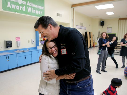 Lisa Macht, a first-grade teacher at Esquire Hill Elementary School, hugs Douglas Grout, a Port Orchard resident who is the senior vice president of Inspirus Credit Union. Inspirus fulfilled DonorsChoose requests for teachers in communities where its employees live.