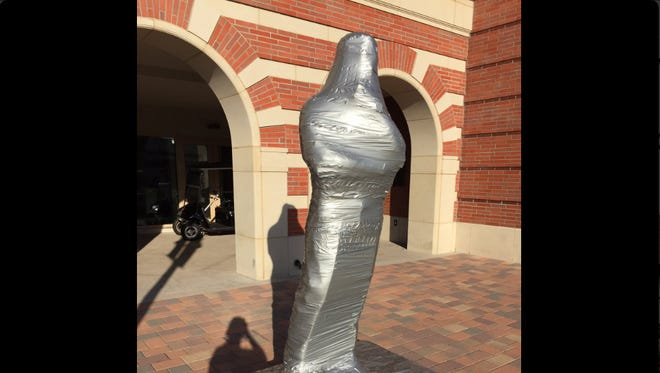 Tommy Trojan is covered in duct tape before the USC-UCLA football game in 2016.