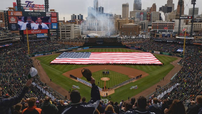 Fans stand during the opening ceremony of Opening Day for the Detroit Tigers at Comerica Park in Detroit on Friday, March 30, 2018.
