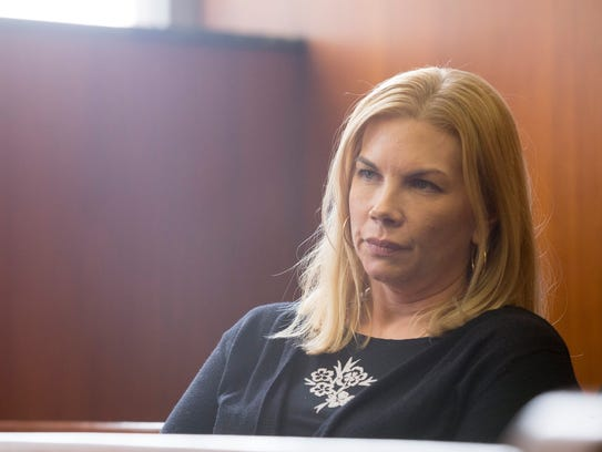 Nicole Beverly sits in the courtroom after testifying against her ex-husband on Monday, April 2, 2018, at Washtenaw Country Trial Court in Ann Arbor.