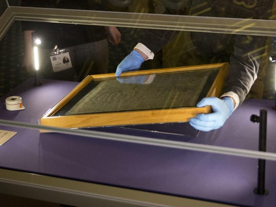 In this file photo dated Thursday, Feb. 5, 2015, The Salisbury Cathedral 1215 copy of the Magna Carta is installed in a glass display cabinet marking the 800th anniversary of the sealing of Magna Carta at Runnymede in 1215, in Salisbury, England.