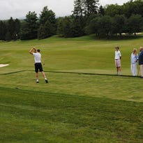 Cornelia Vanderbilt hits the first shot at Biltmore Forest Country Club on July 4, 1922.