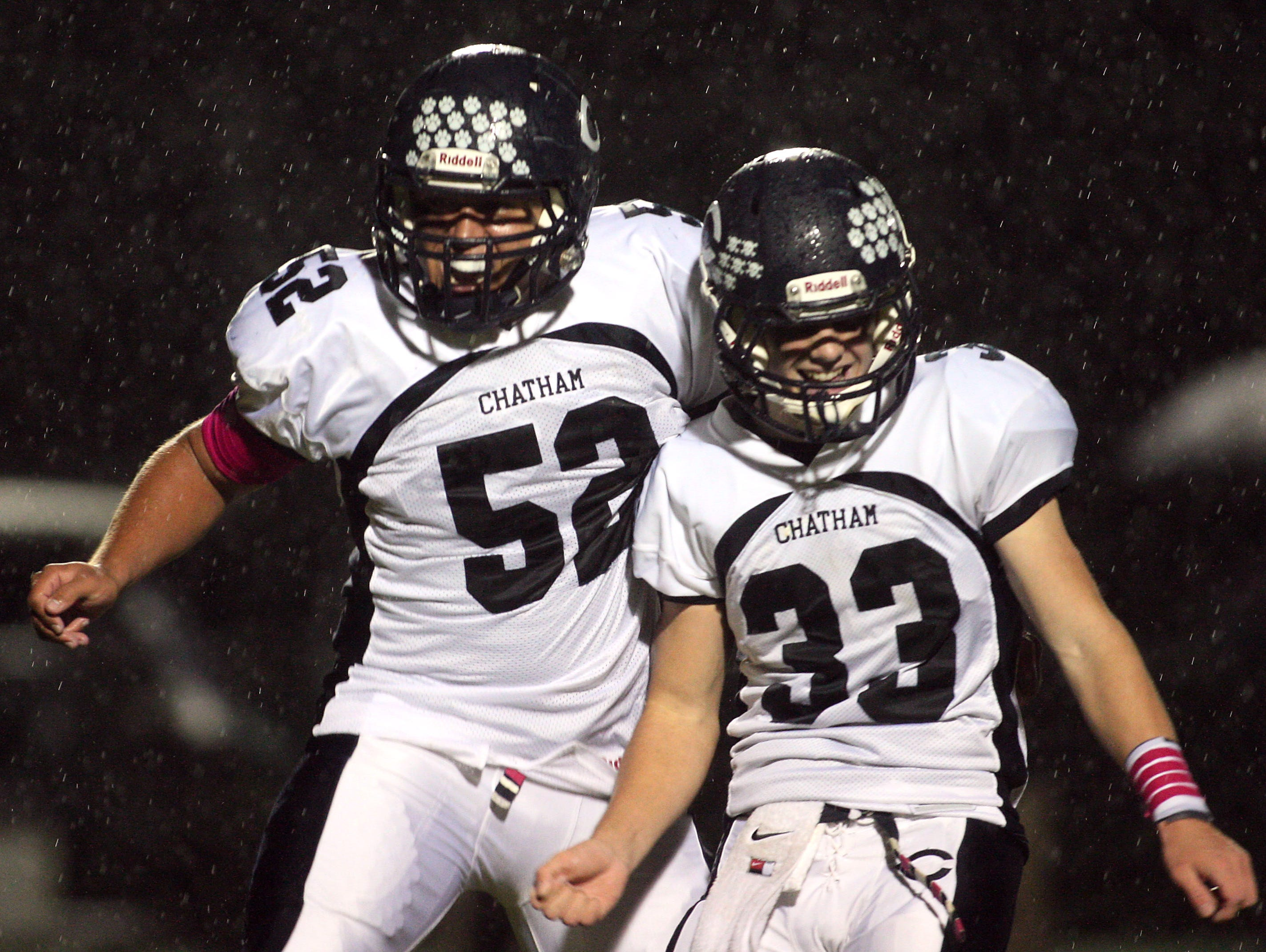 Linebacker Nick Zack, l, and Justin Hayes celebrates a Chatham safety vs. Montville during their Friday night football matchup. October 2, 2015, Montville, NJ.