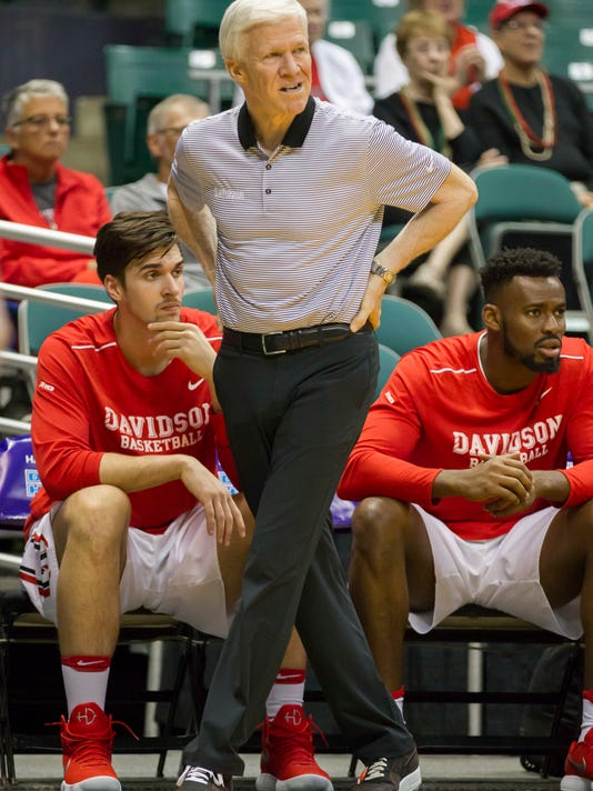 Davidson head coach Bob McKillop looks on from court side as his team plays Akron during the first half of an NCAA college basketball game at the Diamond Head Classic, Monday, Dec. 25, 2017, in Honolulu. (AP Photo/Eugene Tanner)