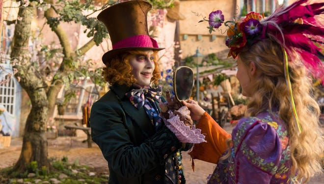 "Johnny Depp, left, and Mia Wasikowska appear in a scene from ""Alice Through The Looking Glass."""