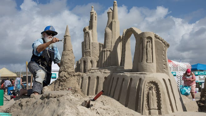Walter McDonald of South Padre Island constructs a sand sculpture in the master duo competition Saturday, April 22, 2017, during Texas SandFest in Port Aransas. His partner, Christy McDonald Atkinson, is not pictured.