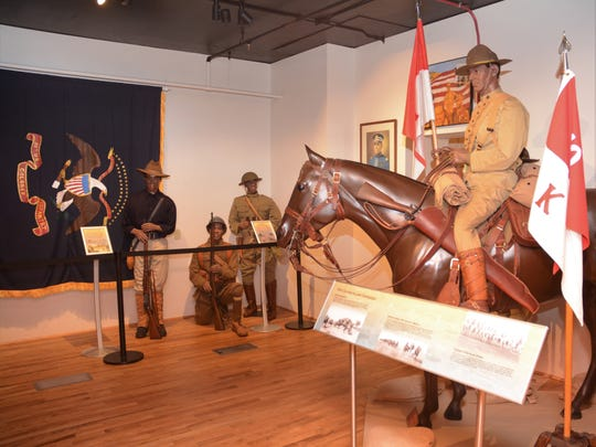 Various uniforms worn by Buffalo Soldiers are depicted