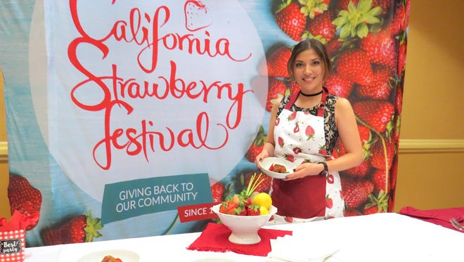 Berry Blast Off recipe contest competitor Lizet Melgoza poses with her dish during semifinalist judging. Melgoza and fellow finalist Jake Hagen will face off again Saturday during the California Strawberry Festival in Oxnard.