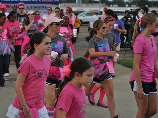 Komen supporters run Saturday in the 5th annual Pink Dress Run in Alexandria.