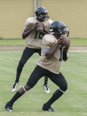 Wetumpka quarterbacks Deandre Ezell and Keldon Washington go through drills.