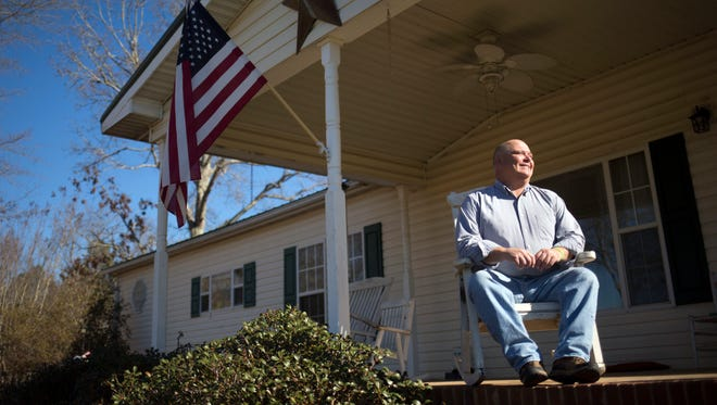 Pelham Medlock, a former Anderson fire chief who received a liver transplant, sits on his front porch on Friday, February 17, 2017 in Belton.