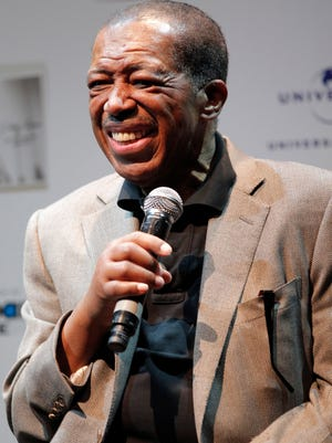 Ben E. King smiles during a 2011 news conference in Tokyo.