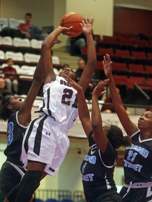 Ossining's Shadeen Samuels drives through traffic in a game against Grand Street Campus  during the Slam Dunk Tournament at the Westchester County Center in White Plains on Saturday.