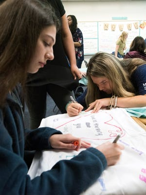 Gulf Breeze High School students Alexandra Smith and Sydney Brown decorate pillowcases Tuesday, April 3, 2018. Members of the school's Homefront Heroes club are decorating the pillowcases to send to students at Marjory Stoneman Douglas High School, the site of a Feb. 14 mass shooting.