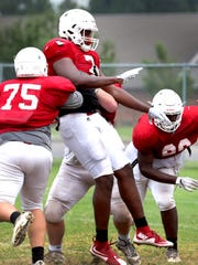 Oakland defensive lineman Joseph Anderson (7) battles during Monday's practice.