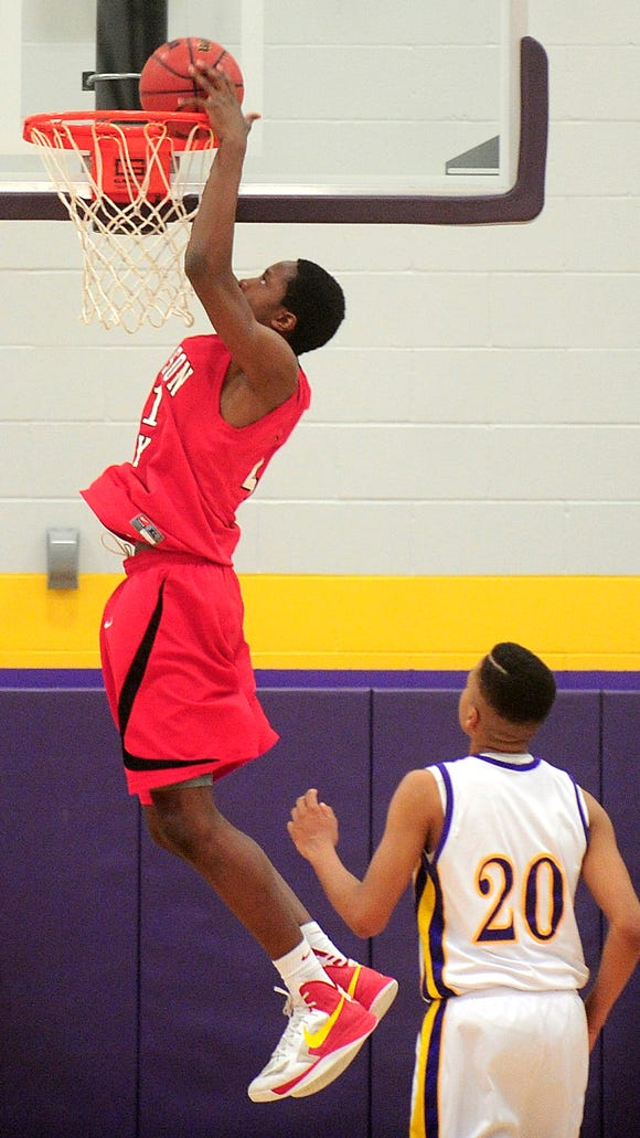 Jefferson City's Ogugua Anunoby dunks the ball during the fourth quarter.Don Shrubshell/ Columbia TribuneFeb. 2013/Sports/Basketball - B HHS-Jeff City