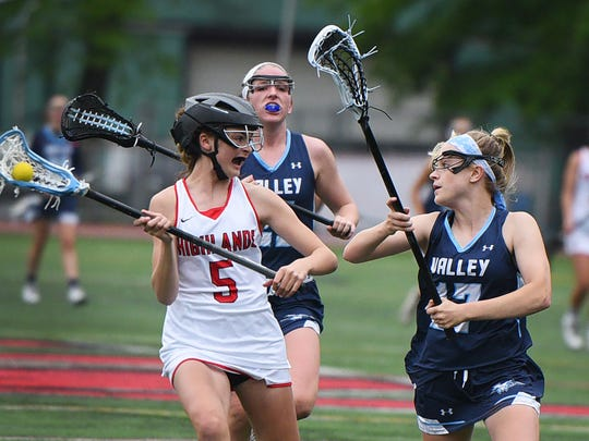 Julia Hill (no. 5) of Northern Highlands runs with the ball as Karli Nevard (no. 17) of Wayne Valley tries to block her in the first half during the North 1, Group 3 girls lacrosse state semifinal game at Northern Highlands High School in Allendale on May 22nd, 2017. Northern Highlands defeated Wayne Valley 14 to 1.