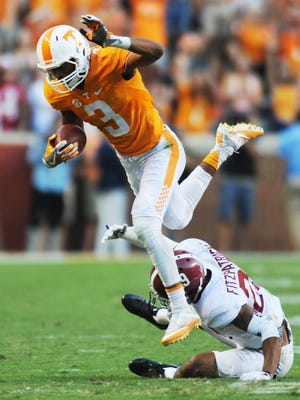 Tennessee wide receiver Josh Malone (3) jumps over Alabama defensive back Minkah Fitzpatrick (29) during the UT vs. Alabama game in Neyland Stadium on Saturday, Oct. 15, 2016. Alabama defeated UT 49-10.