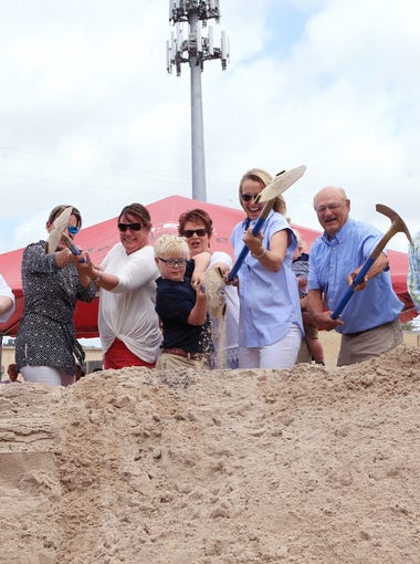 Jack Rumley (center), 11, and his mother, Sherry Rumley, founder of the Rise School of Corpus Christi, participate in the groundbreaking of a new $1.6 million campus on school grounds of Annapolis Christian Academy on Tuesday, April 25, 2017. Rumley worked to open the inclusive pre-school 10 years ago when her son Jack was born with Down syndrome. The school includes students who are traditional learners and who are special-needs students learning side-by-side.